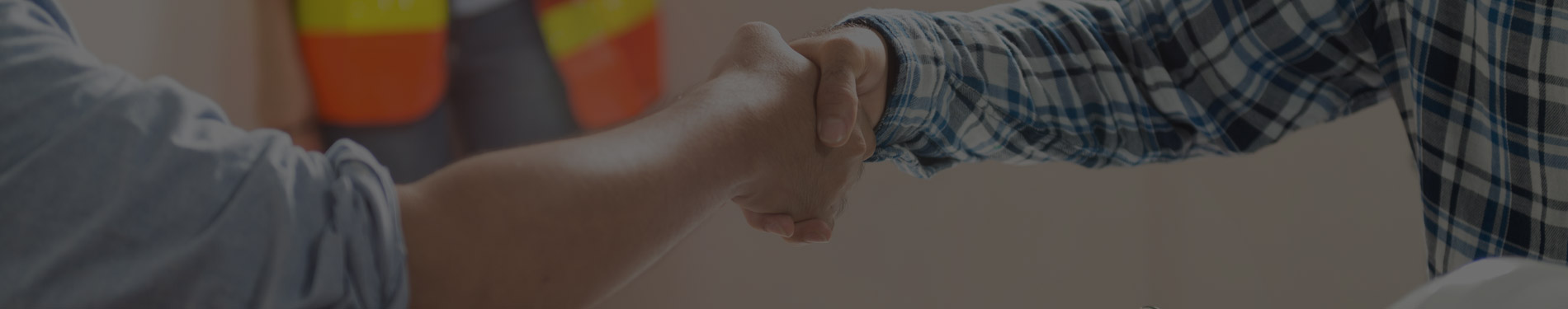 contractor and customer shake hands